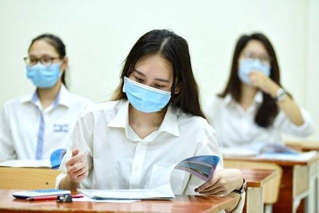 Học sinh phải đeo khẩu trang trong suốt quá trình thi và phòng thi không được bật điều hòa - Ảnh minh họa